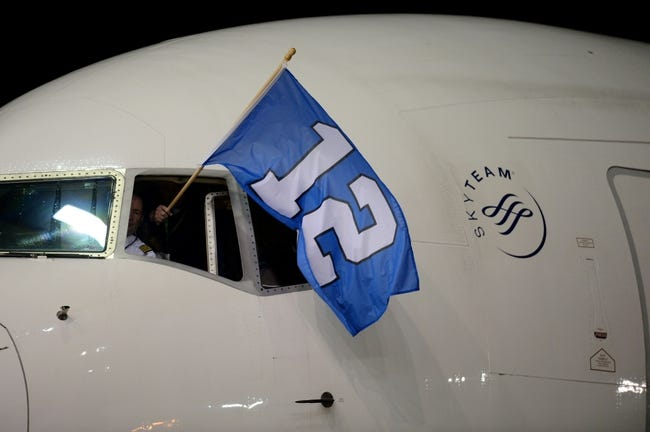 Jan 26, 2014; Newark, NJ, USA; The Seattle Seahawks arrive at Newark Liberty International Airport while displaying their 12th Man flag to face the Denver Broncos in Super Bowl XLVIII. Mandatory Credit: Joe Camporeale-USA TODAY Sports