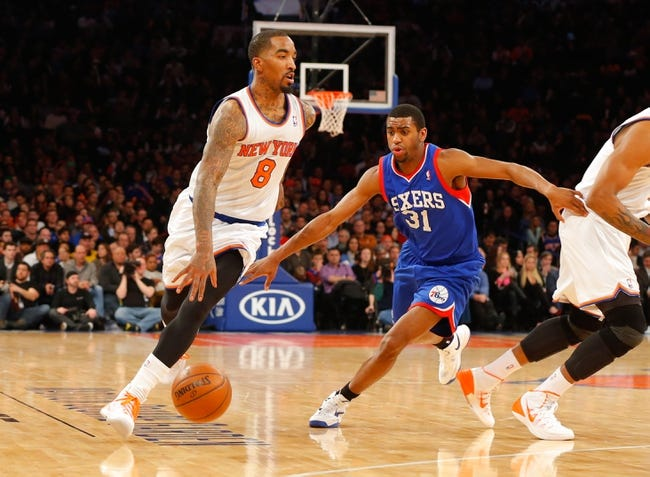 Jan 22, 2014; New York, NY, USA;  New York Knicks shooting guard J.R. Smith (8) works against Philadelphia 76ers shooting guard Hollis Thompson (31) at Madison Square Garden. Philadelphia 76ers defeat the New York Knicks 110-105. Mandatory Credit: Jim O'Connor-USA TODAY Sports