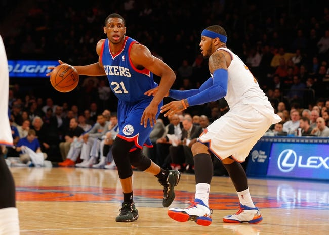 Jan 22, 2014; New York, NY, USA;  Philadelphia 76ers power forward Thaddeus Young (21) brings the ball up court during the first half against New York Knicks small forward Carmelo Anthony (7) at Madison Square Garden. Mandatory Credit: Jim O'Connor-USA TODAY Sports