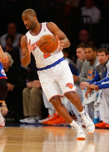 Jan 22, 2014; New York, NY, USA;  New York Knicks point guard Raymond Felton (2) handles the ball during the first half against the Philadelphia 76ers at Madison Square Garden. Mandatory Credit: Jim O'Connor-USA TODAY Sports