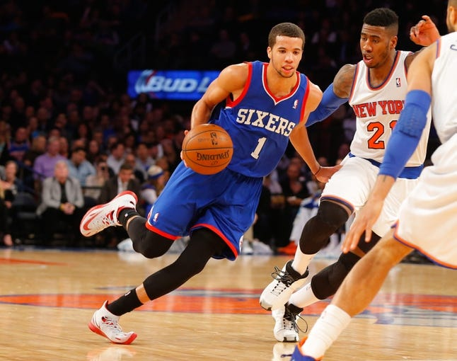 Jan 22, 2014; New York, NY, USA;  Philadelphia 76ers point guard Michael Carter-Williams (1) handles the ball against New York Knicks shooting guard Iman Shumpert (21) at Madison Square Garden. Mandatory Credit: Jim O'Connor-USA TODAY Sports