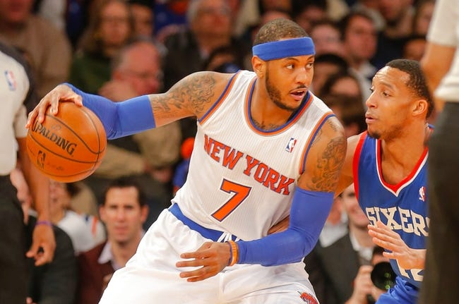 Jan 22, 2014; New York, NY, USA;  New York Knicks small forward Carmelo Anthony (7) works against Philadelphia 76ers small forward Evan Turner (12) during the first half at Madison Square Garden. Mandatory Credit: Jim O'Connor-USA TODAY Sports