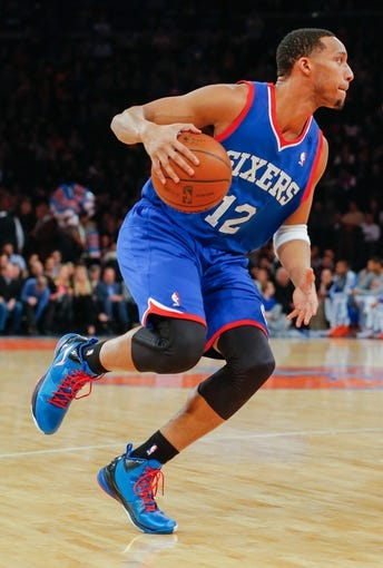 Jan 22, 2014; New York, NY, USA;  Philadelphia 76ers small forward Evan Turner (12) handles the ball during the first half against the New York Knicks at Madison Square Garden. Mandatory Credit: Jim O'Connor-USA TODAY Sports