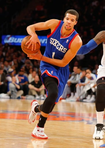 Jan 22, 2014; New York, NY, USA;  Philadelphia 76ers point guard Michael Carter-Williams (1) passes the ball back outside against the New York Knicks at Madison Square Garden. Mandatory Credit: Jim O'Connor-USA TODAY Sports