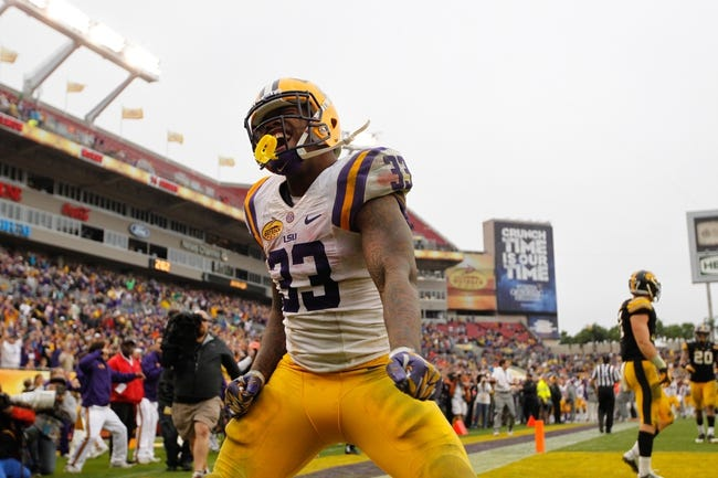Jan 1, 2014; Tampa, Fl, USA; LSU Tigers running back Jeremy Hill (33) reacts and celebrates after he scored a touchdown against the Iowa Hawkeyes during the second half at Raymond James Stadium. LSU Tigers defeated the Iowa Hawkeyes 21-14. Mandatory Credit: Kim Klement-USA TODAY Sports