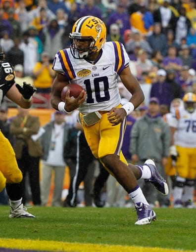 Jan 1, 2014; Tampa, Fl, USA; LSU Tigers quarterback Anthony Jennings (10) runs the ball in for a touchdown against the Iowa Hawkeyes during the first quarter at Raymond James Stadium. Mandatory Credit: Kim Klement-USA TODAY Sports