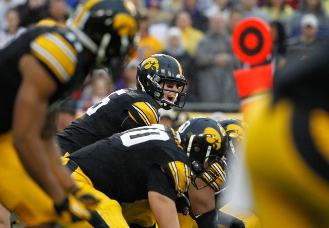 Jan 1, 2014; Tampa, Fl, USA; Iowa Hawkeyes quarterback Jake Rudock (15) calls a play at the line of scrimmage against the LSU Tigers during the first quarter at Raymond James Stadium. Mandatory Credit: Kim Klement-USA TODAY Sports