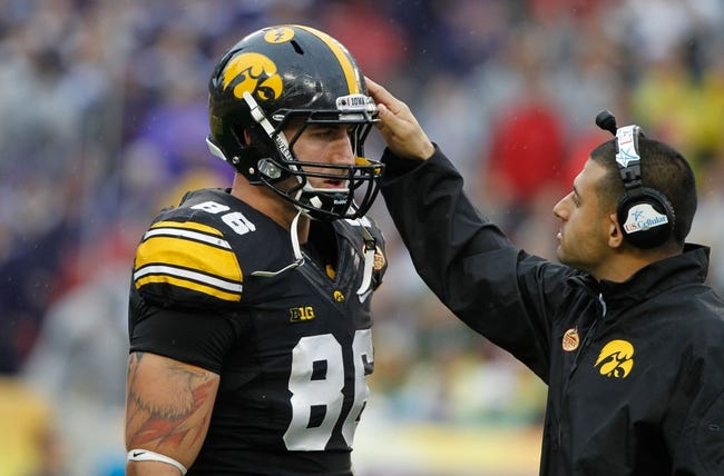 Jan 1, 2014; Tampa, Fl, USA; Iowa Hawkeyes graduate assistant and tight end coach DJ Hernandez talks with tight end C.J. Fiedorowicz (86)  during the first quarter against the LSU Tigers at Raymond James Stadium. Mandatory Credit: Kim Klement-USA TODAY Sports