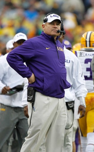 Jan 1, 2014; Tampa, Fl, USA; LSU Tigers head coach Les Miles against the Iowa Hawkeyes during the second half at Raymond James Stadium. LSU Tigers defeated the Iowa Hawkeyes 21-14. Mandatory Credit: Kim Klement-USA TODAY Sports