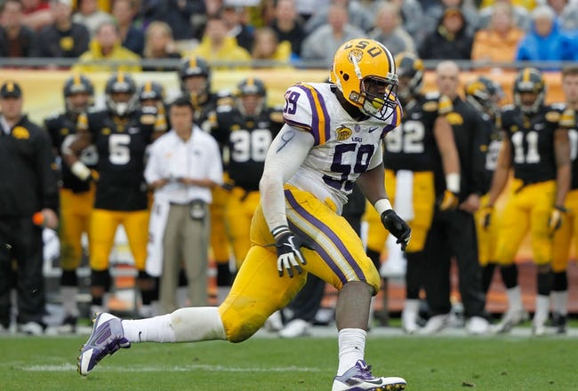 Jan 1, 2014; Tampa, Fl, USA; LSU Tigers defensive end Jermauria Rasco (59) rushes against the Iowa Hawkeyes during the second half at Raymond James Stadium. LSU Tigers defeated the Iowa Hawkeyes 21-14. Mandatory Credit: Kim Klement-USA TODAY Sports