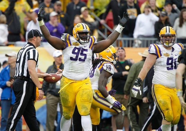 Jan 1, 2014; Tampa, Fl, USA; LSU Tigers defensive tackle Quentin Thomas (95) reacts against the Iowa Hawkeyes during the second half at Raymond James Stadium. LSU Tigers defeated the Iowa Hawkeyes 21-14. Mandatory Credit: Kim Klement-USA TODAY Sports
