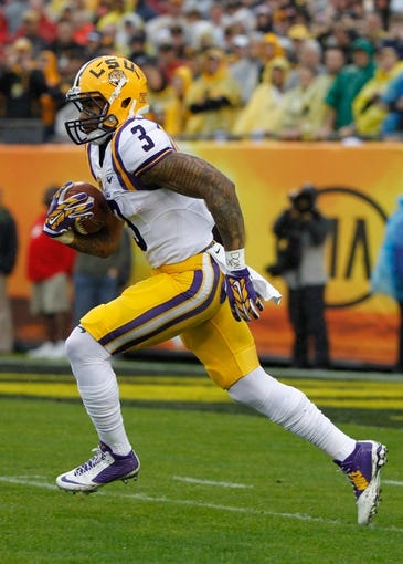 Jan 1, 2014; Tampa, Fl, USA; LSU Tigers wide receiver Odell Beckham (3) runs with the ball against the Iowa Hawkeyes during the first quarter at Raymond James Stadium. Mandatory Credit: Kim Klement-USA TODAY Sports