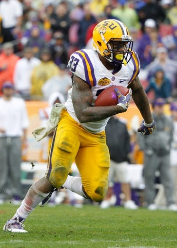 Jan 1, 2014; Tampa, Fl, USA; LSU Tigers running back Jeremy Hill (33) runs with the ball against the Iowa Hawkeyes during the first half at Raymond James Stadium. Mandatory Credit: Kim Klement-USA TODAY Sports
