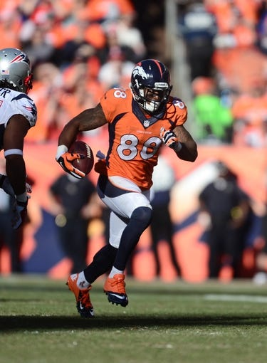 January 19, 2014; Denver, CO, USA; Denver Broncos wide receiver Demaryius Thomas (88) runs after a reception against the New England Patriots in the first half of the 2013 AFC Championship football game at Sports Authority Field at Mile High. Mandatory Credit: Ron Chenoy-USA TODAY Sports