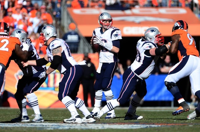 January 19, 2014; Denver, CO, USA; New England Patriots quarterback Tom Brady (12) looks to pass in the second half against the Denver Broncos in the 2013 AFC Championship football game at Sports Authority Field at Mile High. Mandatory Credit: Ron Chenoy-USA TODAY Sports
