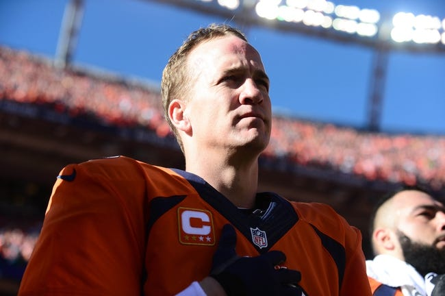 January 19, 2014; Denver, CO, USA; Denver Broncos quarterback Peyton Manning (18) before the game against the New England Patriots in the 2013 AFC Championship football game at Sports Authority Field at Mile High. Mandatory Credit: Ron Chenoy-USA TODAY Sports