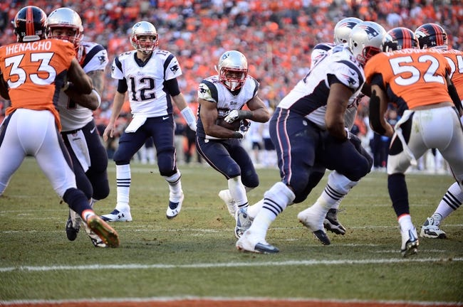 January 19, 2014; Denver, CO, USA; New England Patriots running back Shane Vereen (34) takes a handoff from quarterback Tom Brady (12) in the fourth quarter against the Denver Broncos in the 2013 AFC Championship football game at Sports Authority Field at Mile High. Mandatory Credit: Ron Chenoy-USA TODAY Sports