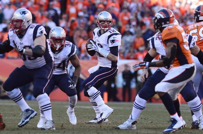 January 19, 2014; Denver, CO, USA; New England Patriots quarterback Tom Brady (12) in the first half against the Denver Broncos during the 2013 AFC Championship football game at Sports Authority Field at Mile High. Mandatory Credit: Ron Chenoy-USA TODAY Sports