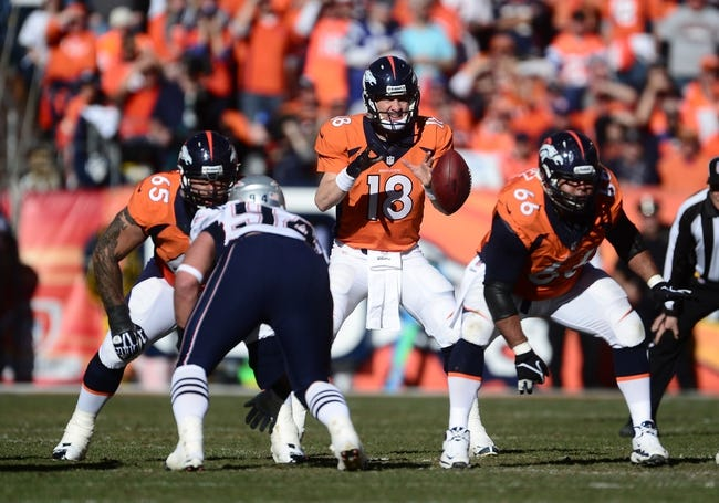 January 19, 2014; Denver, CO, USA; Denver Broncos quarterback Peyton Manning (18) during the first half against the New England Patriots in the 2013 AFC Championship football game at Sports Authority Field at Mile High. Mandatory Credit: Ron Chenoy-USA TODAY Sports