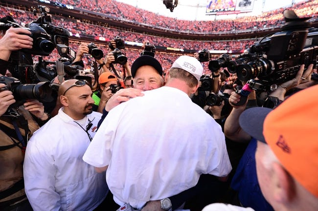 January 19, 2014; Denver, CO, USA; Denver Broncos head coach John Fox hugs quarterback Peyton Manning (18) following the 26-16 victory against the New England Patriots in the 2013 AFC Championship football game at Sports Authority Field at Mile High. Mandatory Credit: Ron Chenoy-USA TODAY Sports
