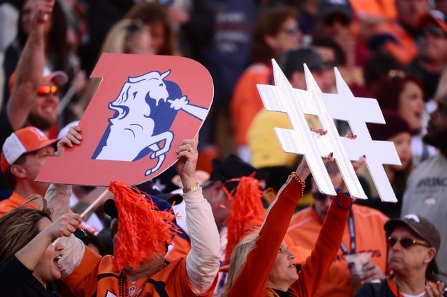 January 19, 2014; Denver, CO, USA; General view of Denver Broncos fans holding defense signs during the game against the New England Patriots in the first half of the 2013 AFC Championship football game at Sports Authority Field at Mile High. Mandatory Credit: Ron Chenoy-USA TODAY Sports