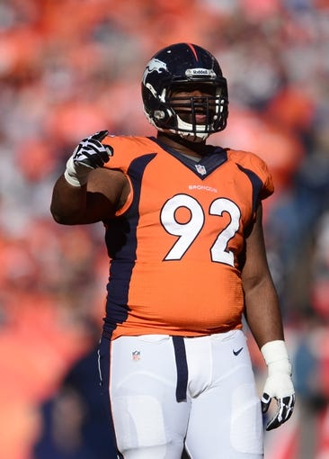 January 19, 2014; Denver, CO, USA; Denver Broncos defensive tackle Sylvester Williams (92) during the first half against the New England Patriots in the 2013 AFC Championship football game at Sports Authority Field at Mile High. Mandatory Credit: Ron Chenoy-USA TODAY Sports