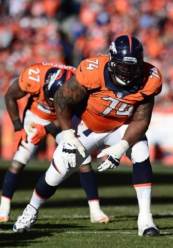 January 19, 2014; Denver, CO, USA; Denver Broncos tackle Orlando Franklin (74) during the game against the New England Patriots in the first half of the 2013 AFC Championship football game at Sports Authority Field at Mile High. Mandatory Credit: Ron Chenoy-USA TODAY Sports