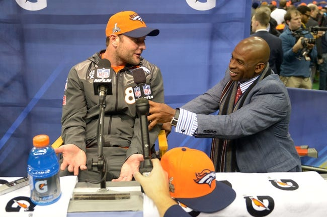 Jan 28, 2014; Newark, NJ, USA; Denver Broncos wide receiver Wes Welker (83) is interviewed by NFL Network analyst Deion Sanders  during Media Day for Super Bowl XLIII at Prudential Center. Mandatory Credit: Kirby Lee-USA TODAY Sports