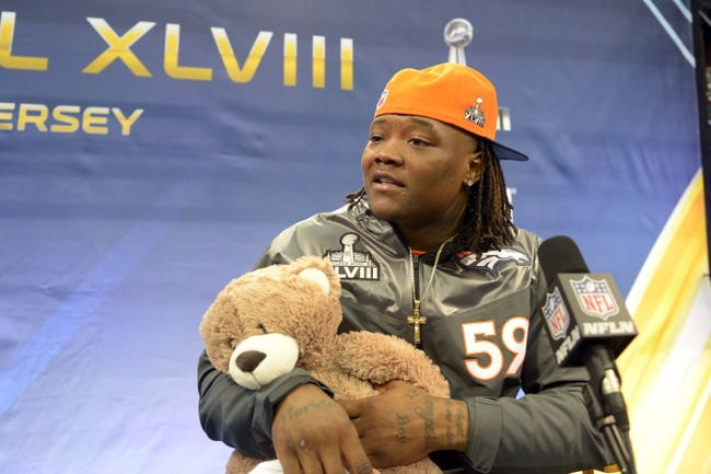 Jan 28, 2014; Newark, NJ, USA; Denver Broncos outside linebacker Danny Trevathan is interviewed during Media Day for Super Bowl XLIII at Prudential Center. Mandatory Credit: Kirby Lee-USA TODAY Sports