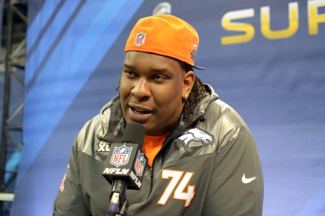 Jan 28, 2014; Newark, NJ, USA; Denver Broncos tackle Orlando Franklin (74) is interviewed during Media Day for Super Bowl XLIII at Prudential Center. Mandatory Credit: Kirby Lee-USA TODAY Sports