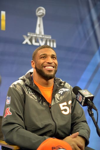Jan 28, 2014; Newark, NJ, USA; Denver Broncos middle linebacker Wesley Woodyard (52) is interviewed during Media Day for Super Bowl XLIII at Prudential Center. Mandatory Credit: Kirby Lee-USA TODAY Sports