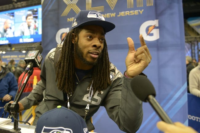 Jan 28, 2014; Newark, NJ, USA; Seattle Seahawks cornerback Richard Sherman (25) is interviewed during Media Day for Super Bowl XLIII at Prudential Center. Mandatory Credit: Kirby Lee-USA TODAY Sports