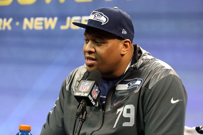 Jan 28, 2014; Newark, NJ, USA; Seattle Seahawks defensive end Red Bryant (79) is interviewed during Media Day for Super Bowl XLIII at Prudential Center. Mandatory Credit: Brad Penner-USA TODAY Sports