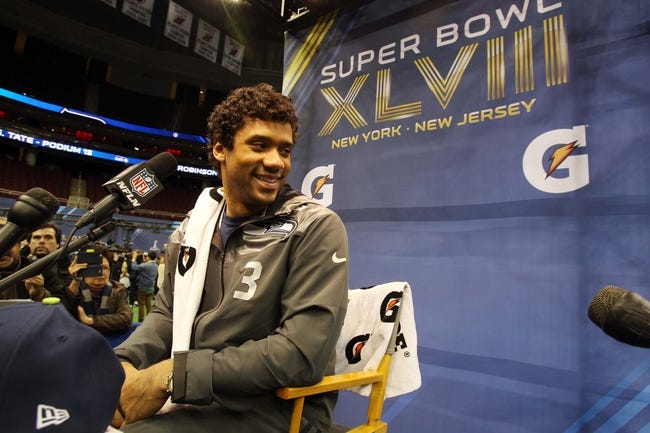 Jan 28, 2014; Newark, NJ, USA; Seattle Seahawks quarterback Russell Wilson is interviewed during Media Day for Super Bowl XLIII at Prudential Center. Mandatory Credit: Brad Penner-USA TODAY Sports