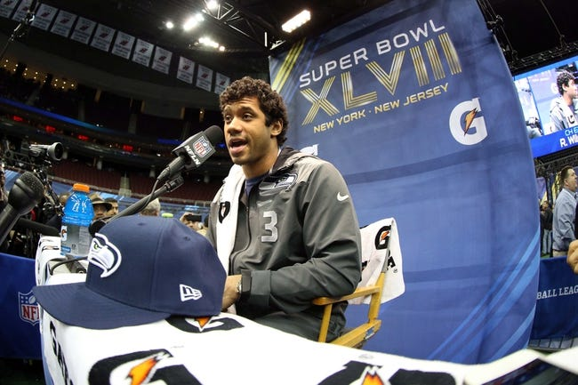 Jan 28, 2014; Newark, NJ, USA; Seattle Seahawks quarterback Russell Wilson (3) is interviewed during Media Day for Super Bowl XLIII at Prudential Center. Mandatory Credit: Brad Penner-USA TODAY Sports