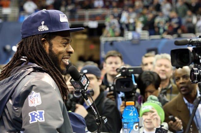 Jan 28, 2014; Newark, NJ, USA; Seattle Seahawks cornerback Richard Sherman (25) is interviewed during Media Day for Super Bowl XLIII at Prudential Center. Mandatory Credit: Brad Penner-USA TODAY Sports
