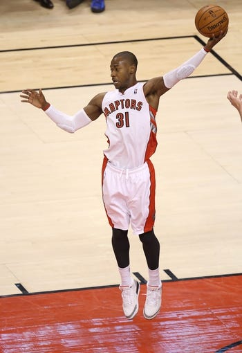 Jan 29, 2014; Toronto, Ontario, CAN; Toronto Raptors guard Terrence Ross (31) comes up with a rebound against the Orlando Magic at Air Canada Centre. The Raptors beat the Magic 98-83. Mandatory Credit: Tom Szczerbowski-USA TODAY Sports