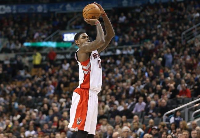 Jan 29, 2014; Toronto, Ontario, CAN; Toronto Raptors forward Amir Johnson (15) shoots against the Orlando Magic at Air Canada Centre. The Raptors beat the Magic 98-83. Mandatory Credit: Tom Szczerbowski-USA TODAY Sports