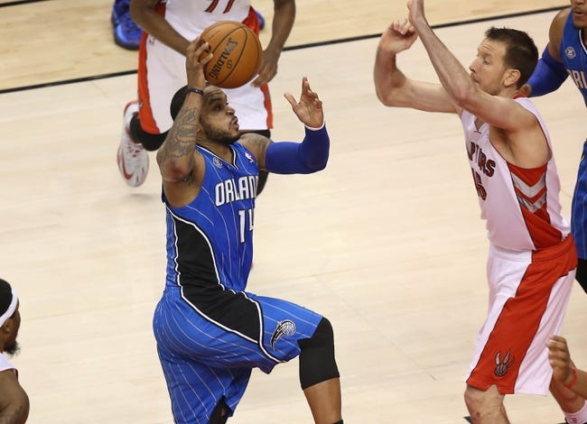 Jan 29, 2014; Toronto, Ontario, CAN; Orlando Magic guard Jameer Nelson (14) goes to the basket against the Toronto Raptors at Air Canada Centre. The Raptors beat the Magic 98-83. Mandatory Credit: Tom Szczerbowski-USA TODAY Sports