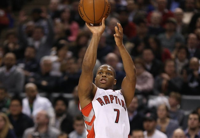 Jan 29, 2014; Toronto, Ontario, CAN; Toronto Raptors point guard Kyle Lowry (7) shoots a three point basket against the Orlando Magic at Air Canada Centre. The Raptors beat the Magic 98-83. Mandatory Credit: Tom Szczerbowski-USA TODAY Sports