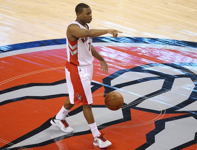 Jan 29, 2014; Toronto, Ontario, CAN; Toronto Raptors point guard Kyle Lowry (7) brings the ball up the court against the Orlando Magic at Air Canada Centre. The Raptors beat the Magic 98-83. Mandatory Credit: Tom Szczerbowski-USA TODAY Sports