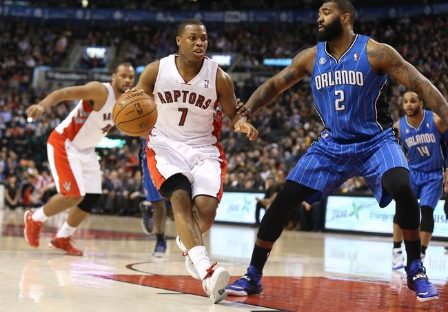 Jan 29, 2014; Toronto, Ontario, CAN; Toronto Raptors point guard Kyle Lowry (7) moves the ball against the defense of Orlando Magic forward Kyle O'Quinn (2) at Air Canada Centre. The Raptors beat the Magic 98-83. Mandatory Credit: Tom Szczerbowski-USA TODAY Sports