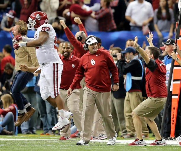 Jan 2, 2014; New Orleans, LA, USA; Oklahoma Sooners head coach Bob Stoops smiles as his defense hold the Alabama Crimson Tide near the end of  the Sugar Bowl at the Mercedes-Benz Superdome. Oklahoma won, 45-31. Mandatory Credit: Chuck Cook-USA TODAY Sports