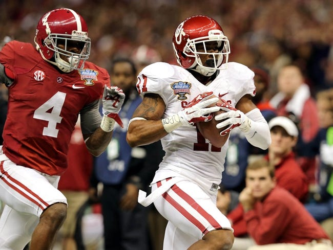 Jan 2, 2014; New Orleans, LA, USA; Oklahoma Sooners wide receiver Lacoltan Bester (11) beats Alabama Crimson Tide defensive back Eddie Jackson (4) for a reception during the second half of the Sugar Bowl at the Mercedes-Benz Superdome. Mandatory Credit: Chuck Cook-USA TODAY Sports