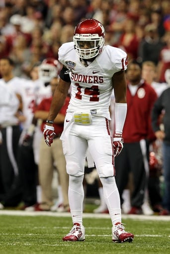 Jan 2, 2014; New Orleans, LA, USA; Oklahoma Sooners defensive back Aaron Colvin (14) on the field against the Alabama Crimson Tide during the second half of the Sugar Bowl at the Mercedes-Benz Superdome. Mandatory Credit: Chuck Cook-USA TODAY Sports