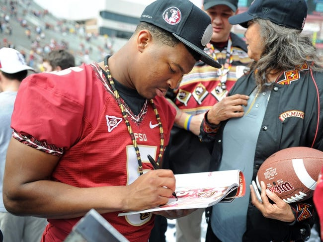 Feb 1, 2014; Tallahassee, FL, USA; Florida State Seminoles quarterback Jameis Winston (5) signs autographs during the BCS National Championship Celebration at Doak Campbell Stadium. Mandatory Credit: Melina Vastola-USA TODAY Sports