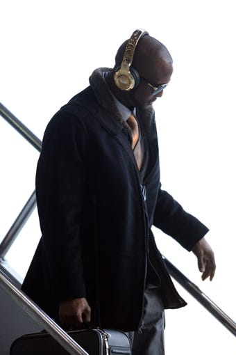 Jan 26, 2014; Newark, NJ, USA; Denver Broncos cornerback Champ Bailey arrives at Newark Liberty International Airport to face the Seattle Seahawks in Super Bowl XLVIII. Mandatory Credit: Joe Camporeale-USA TODAY Sports