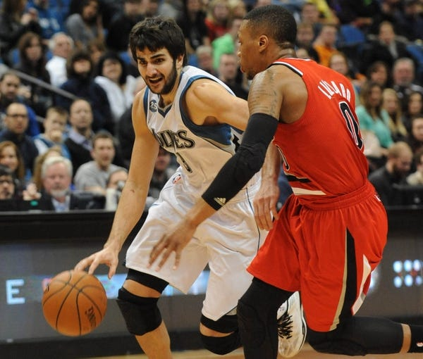 Feb 8, 2014; Minneapolis, MN, USA; Minnesota Timberwolves guard Ricky Rubio (9) drives past Portland Trail Blazers guard Damian Lillard (0) in the fourth quarter at Target Center.  The Trail Blazers defeated the Wolves  117-110.  Mandatory Credit: Marilyn Indahl-USA TODAY Sports