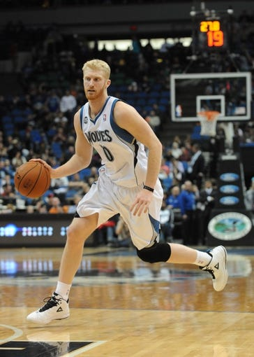 Feb 8, 2014; Minneapolis, MN, USA; Minnesota Timberwolves forward Chase Budinger (10) drives to the basket in the fourth quarter against the Portland Trail Blazers at Target Center.  The Trail Blazers defeated the Wolves  117-110.  Mandatory Credit: Marilyn Indahl-USA TODAY Sports