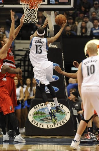 Feb 8, 2014; Minneapolis, MN, USA; Minnesota Timberwolves forward Corey Brewer (13) shoots in the first quarter against the Portland Trail Blazers at Target Center.  The Trail Blazers defeated the Wolves  117-110.  Mandatory Credit: Marilyn Indahl-USA TODAY Sports